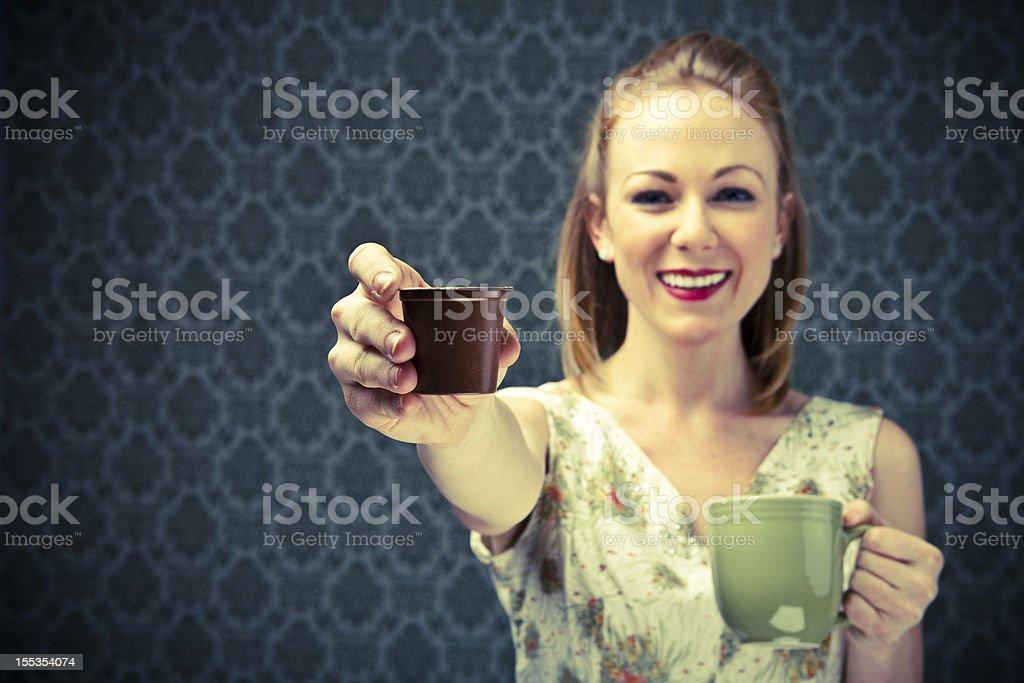 50's Housewife enjoying her coffee capsule stock photo