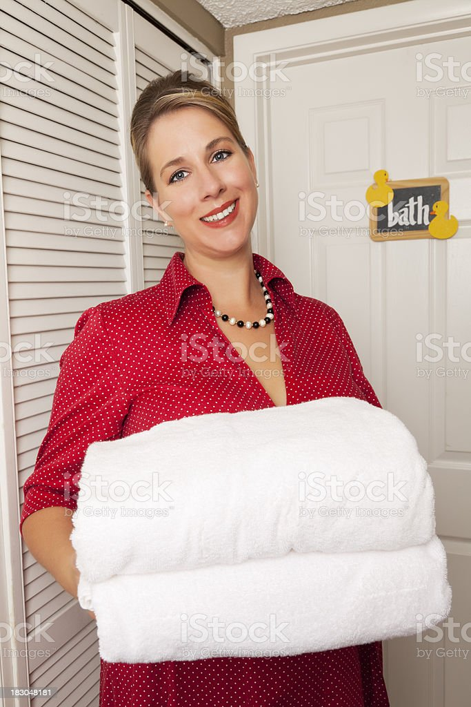 50's housewife offering towles stock photo
