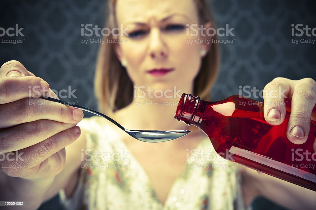 50's Housewife pouring medicine royalty-free stock photo