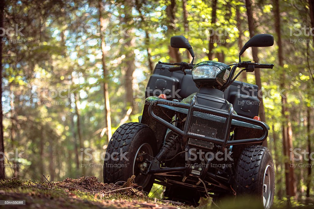 ATV's parked in the parking lot in the forest. stock photo