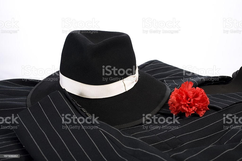 1920's style suit red carnation in lapel and stylish hat. royalty-free stock photo