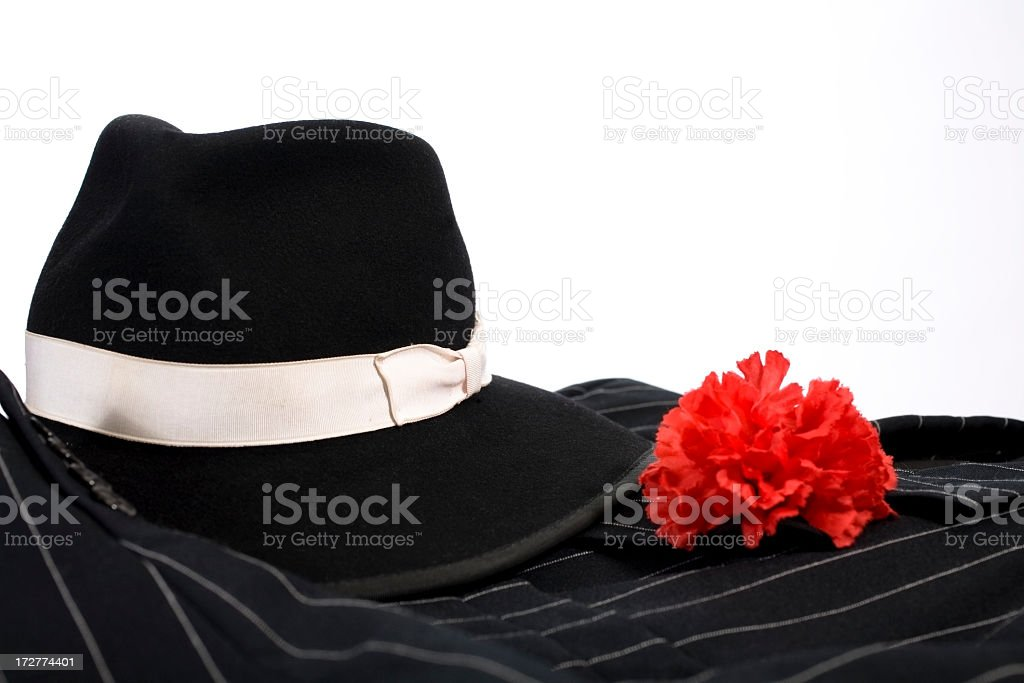 1920's suit, red carnation in lapel, fedora hat. Gangster clothing. stock photo