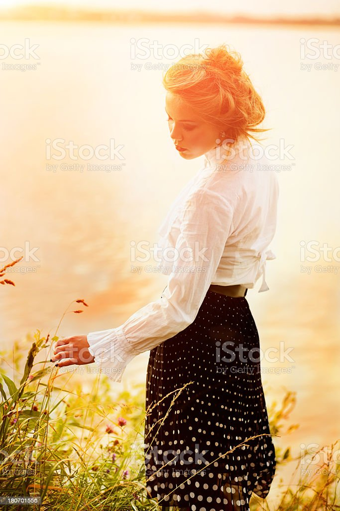 1940's vintage style portrait of a woman in the park stock photo