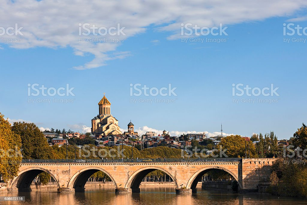 Saarbrucken Bridge and Sameba Cathedral in Tbilisi stock photo