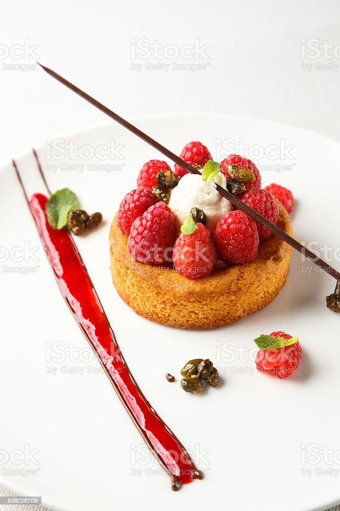 Sable breton or  shortbread with vanilla cream and raspberry coulis stock photo