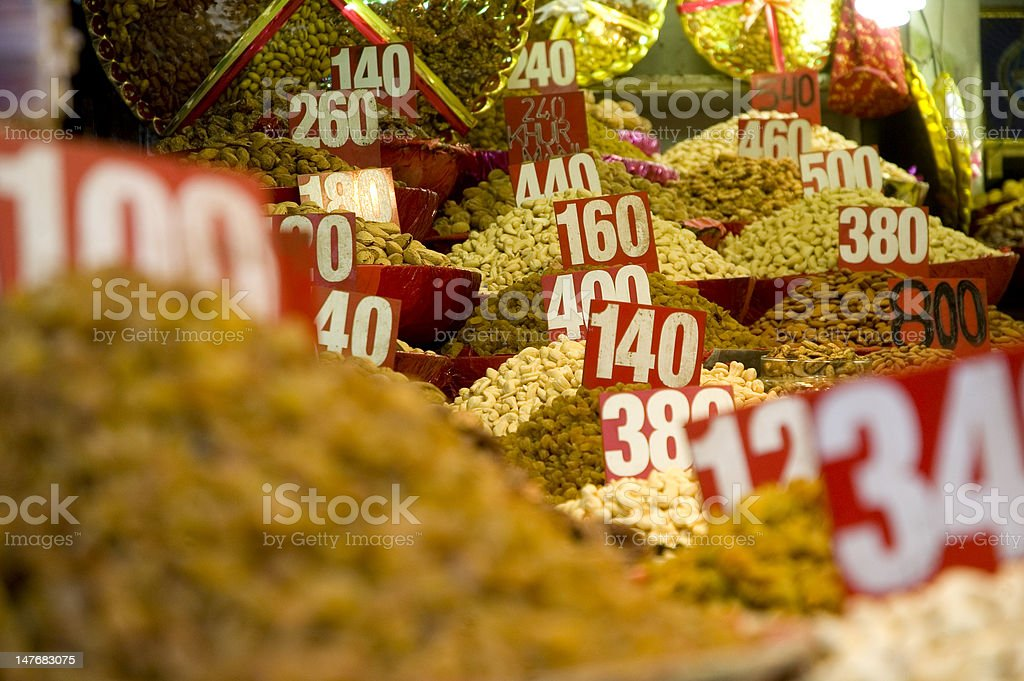Sac of spices and nuts at a market royalty-free stock photo
