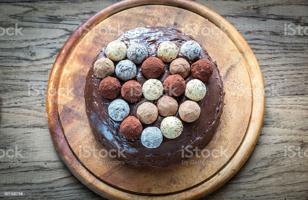 Sacher torte decorated with truffles stock photo