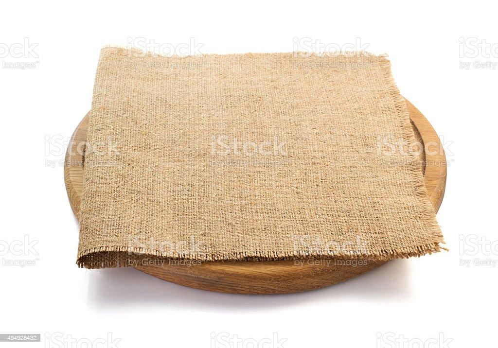 sack burlap napkin at cutting board stock photo