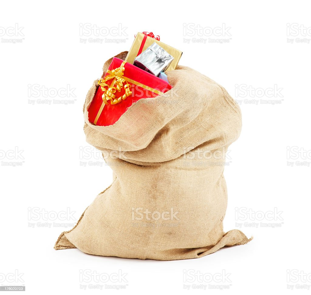 Sack full of gifts over white background royalty-free stock photo
