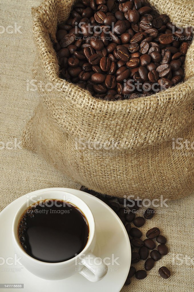 Sack of coffee beans and a cup royalty-free stock photo