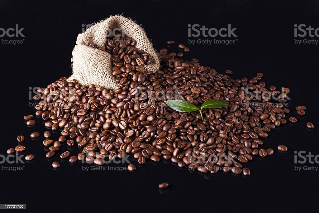 sack of coffee beans on a black background royalty-free stock photo