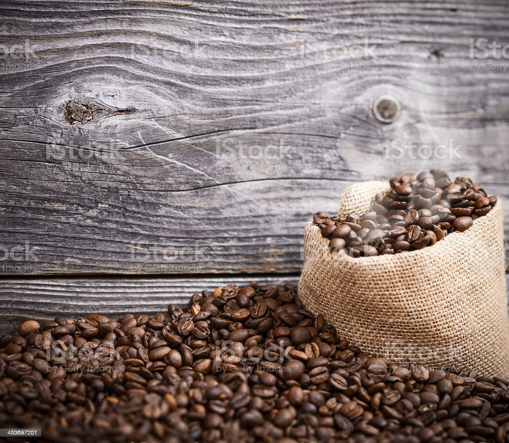 Sack of fresh coffee beans with smoke stock photo
