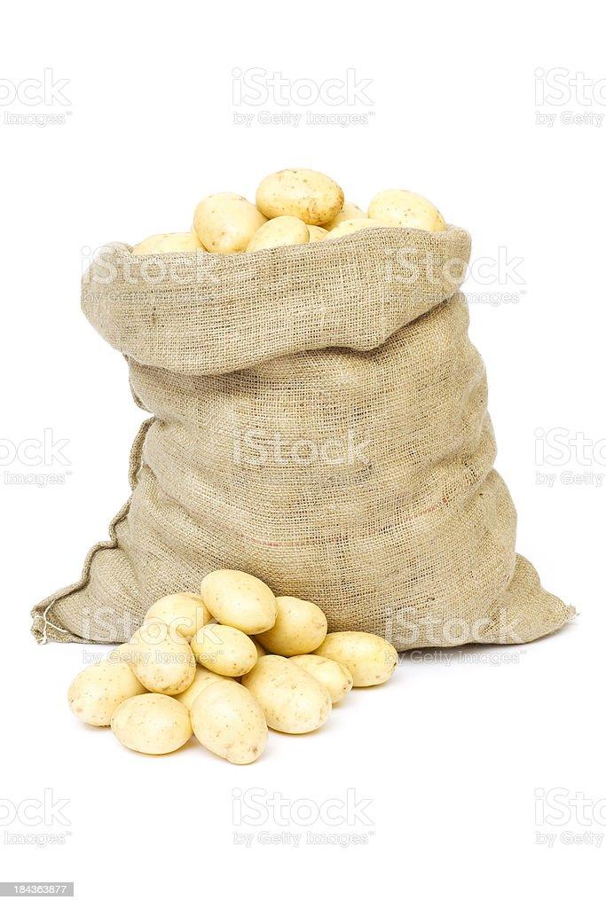 Sack of potatoes isolated on white stock photo