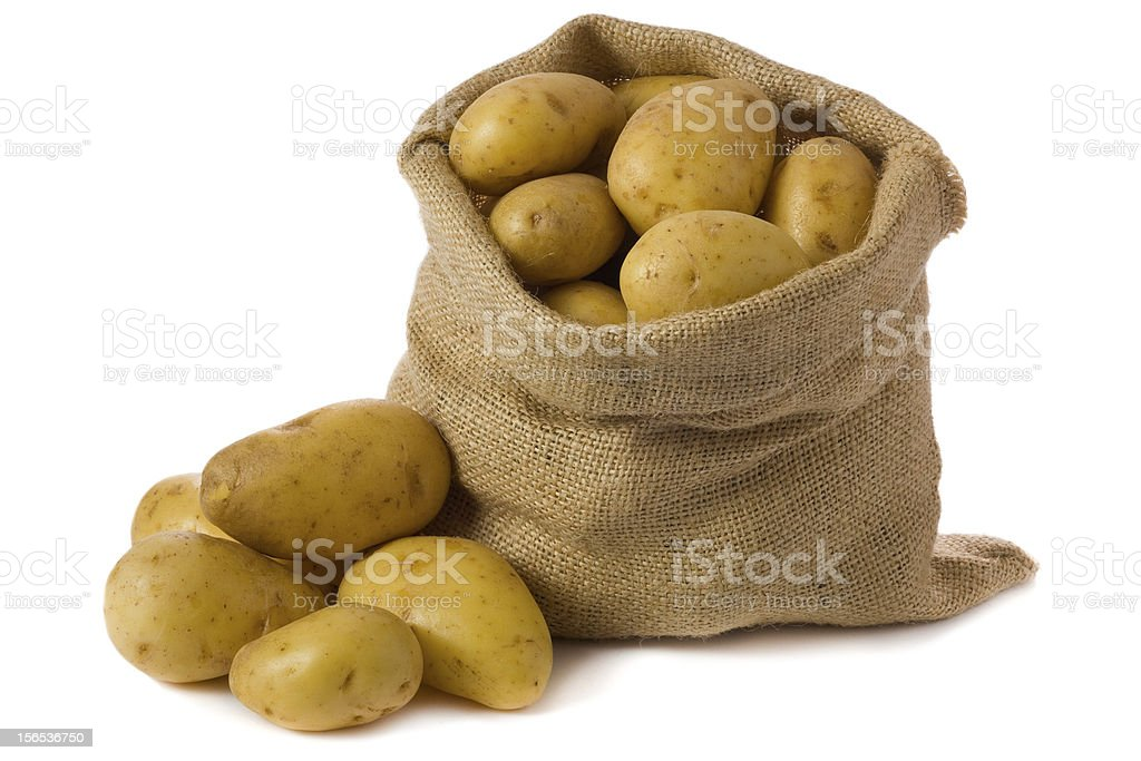 A sack of raw potatoes with some to the side stock photo