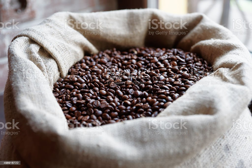 Sack of roasted coffee beans stock photo
