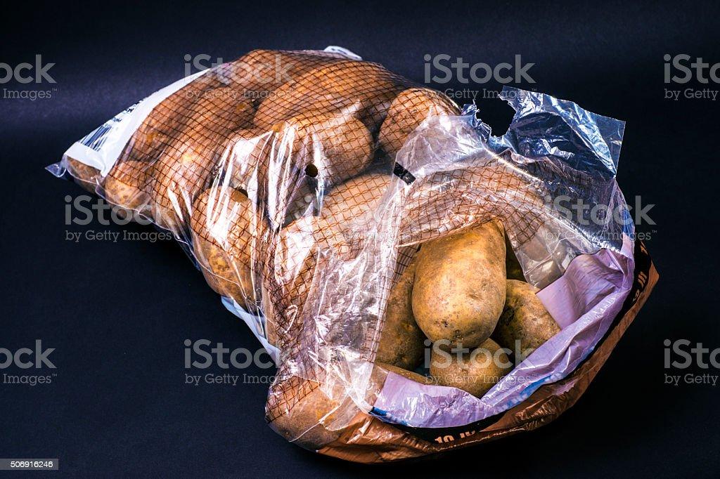 Sack of Russet Potato on Black  Background stock photo