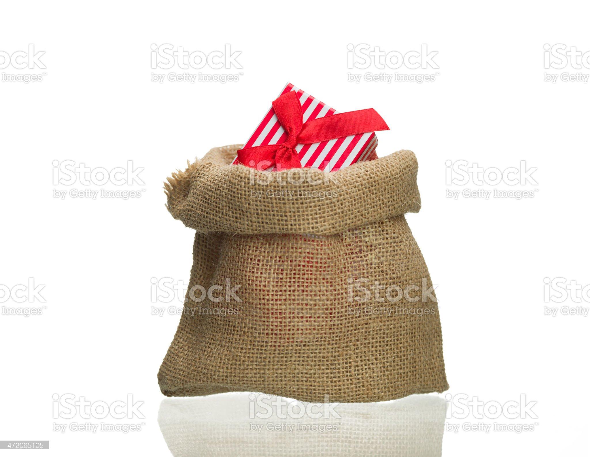 Sack with christmas presents box on white royalty-free stock photo