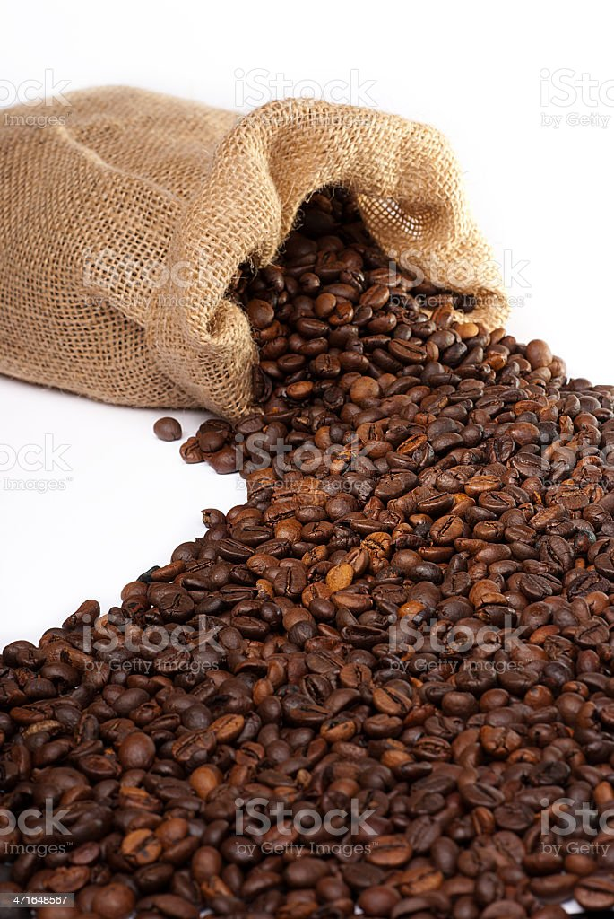Sack with scattered coffee beans royalty-free stock photo