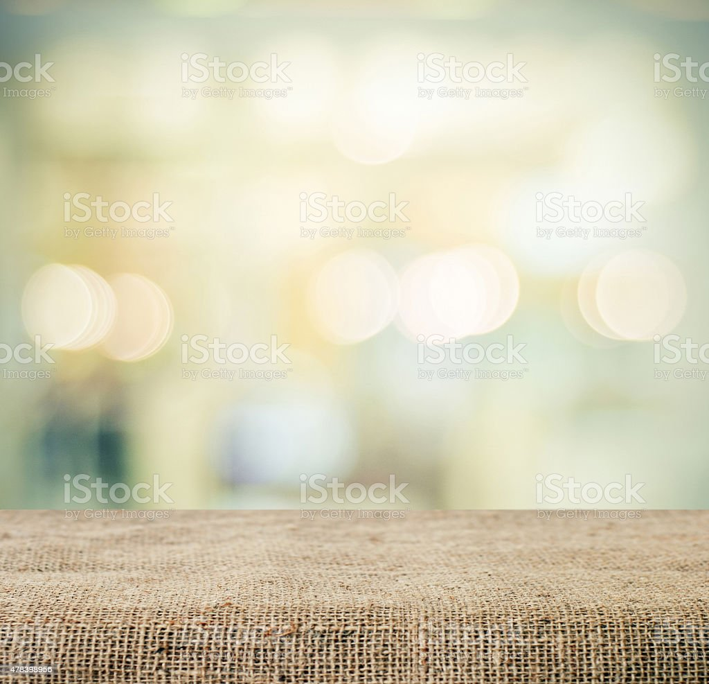 Sackcloth over table and blur bokeh background, product display stock photo
