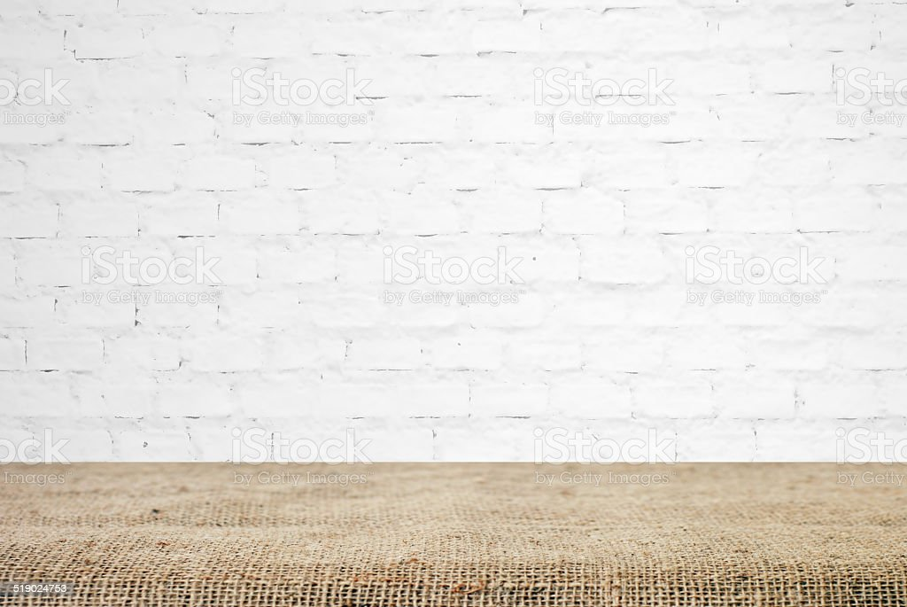 Kitchen Wall Background sackcloth over table and white brick wall background stock photo