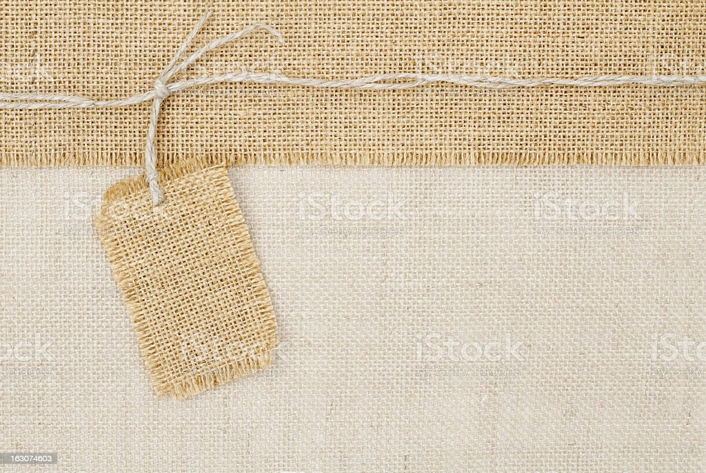 Sackcloth tag pricing over burlap texture royalty-free stock photo