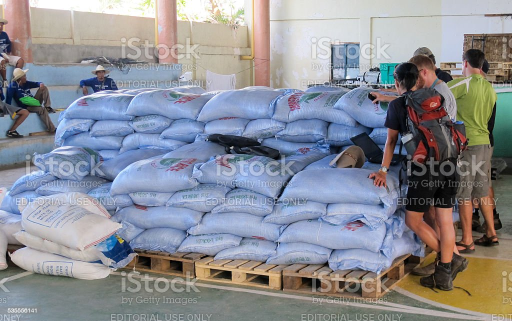 Sacks of rice waiting for distribiution by aid workers stock photo