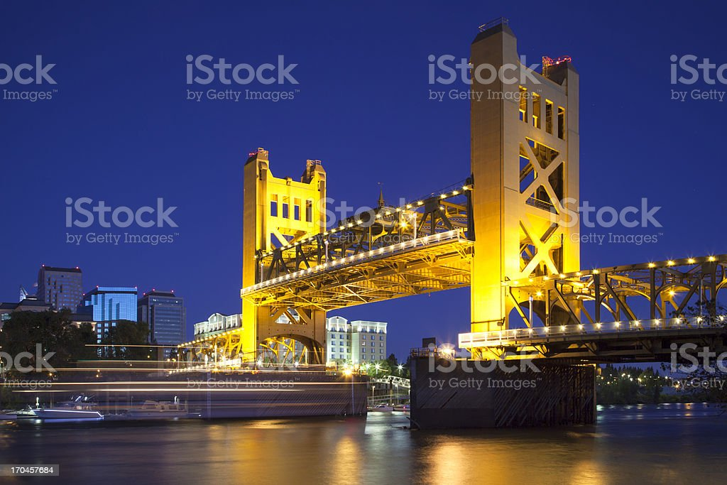 Sacramento River and Tower Bridge raised, at dusk stock photo