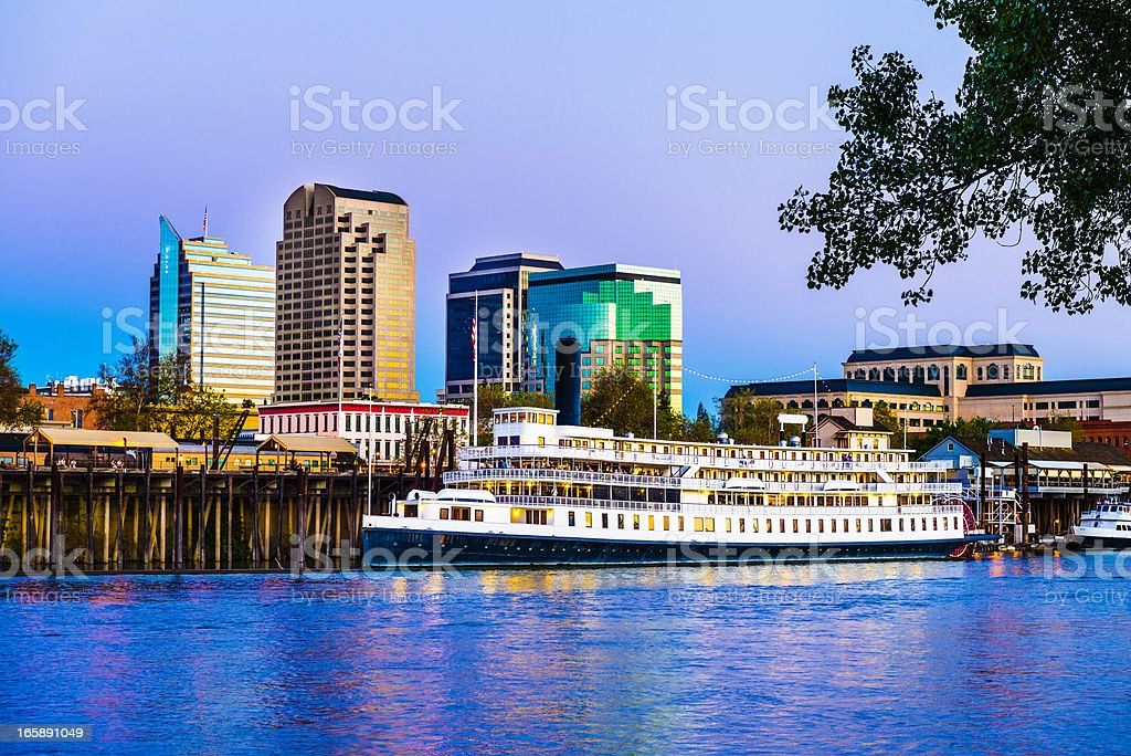 Sacramento skyline and riverfront at dusk stock photo