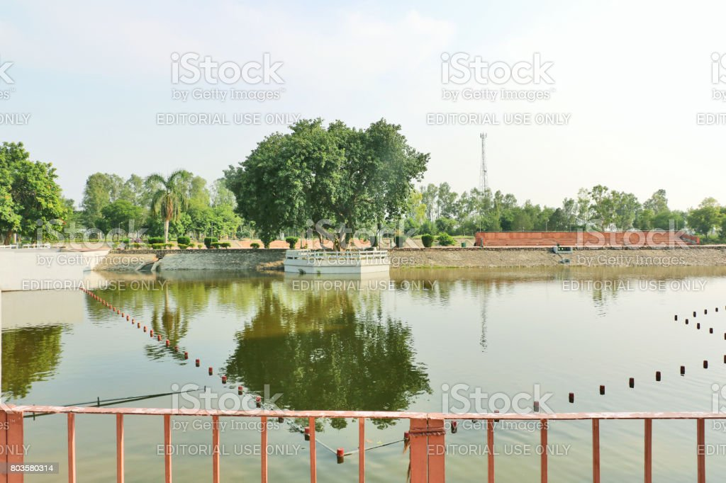 Sacred pond Jyotisar stock photo