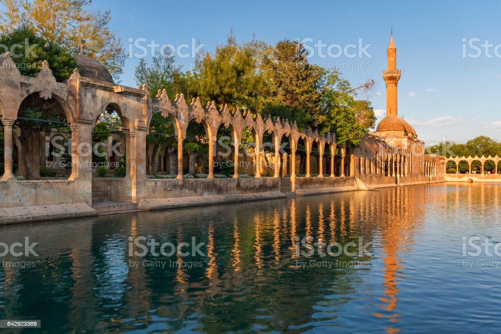 Sacred pool dedicated to Abraham with the reflections of Rizvaniye Mosque, Sanliurfa, Turkey. This area is known as Balikligol. stock photo