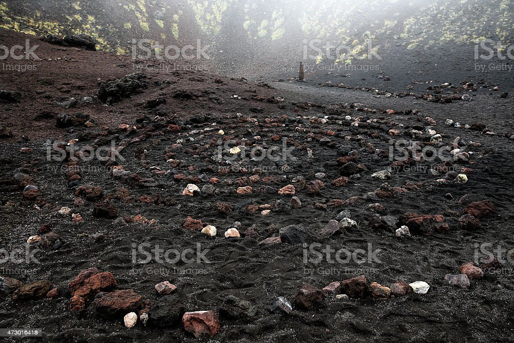 Sacred spiral of igneous rock in Etna volcano crater stock photo