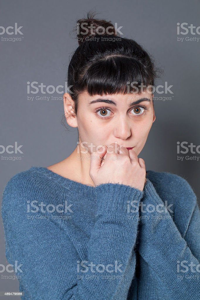 sad 20s fair-skinned girl feeling pain stock photo
