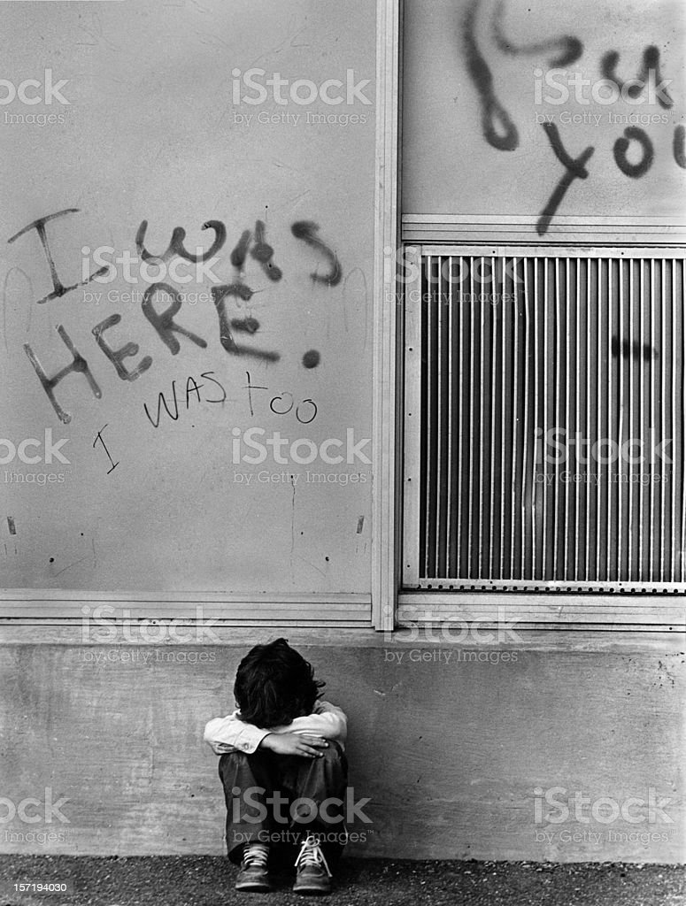 Sad Abused Child Crying Under I Was Here Graffiti Sign stock photo