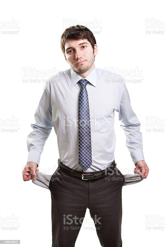 Sad and broke businessman with empty pockets royalty-free stock photo