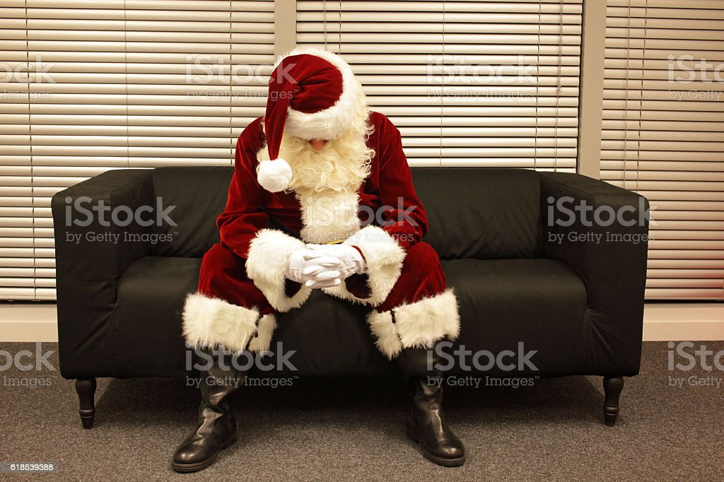 Sad and depressed Santa Claus waiting for christmas stock photo
