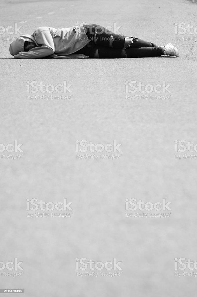 Sad and Heartbroken Girl Sleeping on the Road stock photo