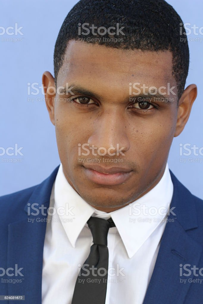 Sad and stressed hansome businessman outside stock photo