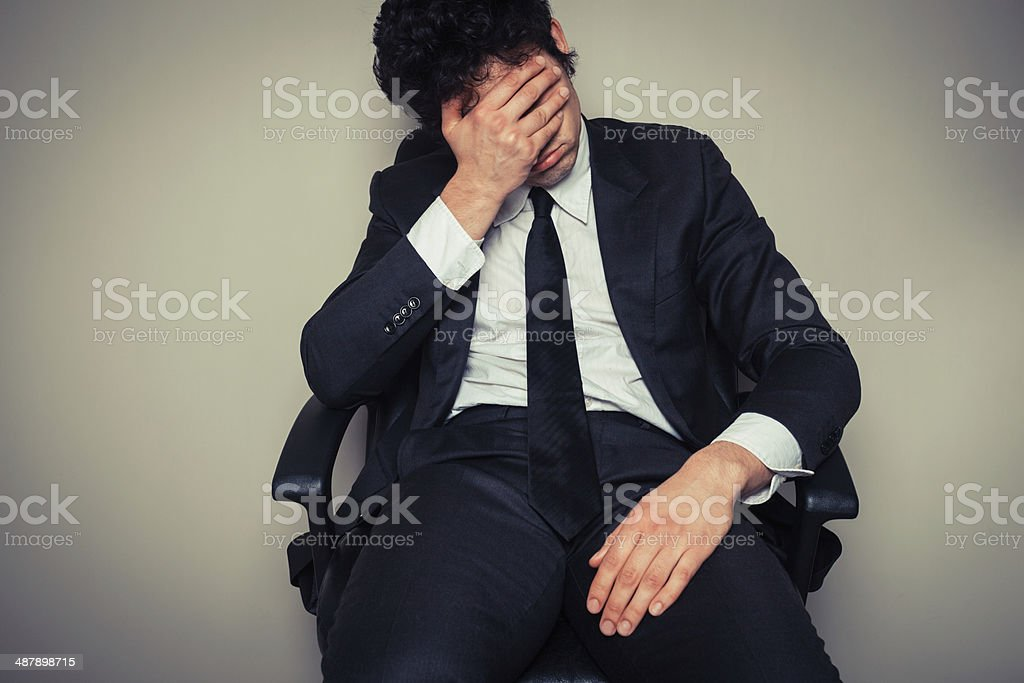 Sad and tired businessman stock photo