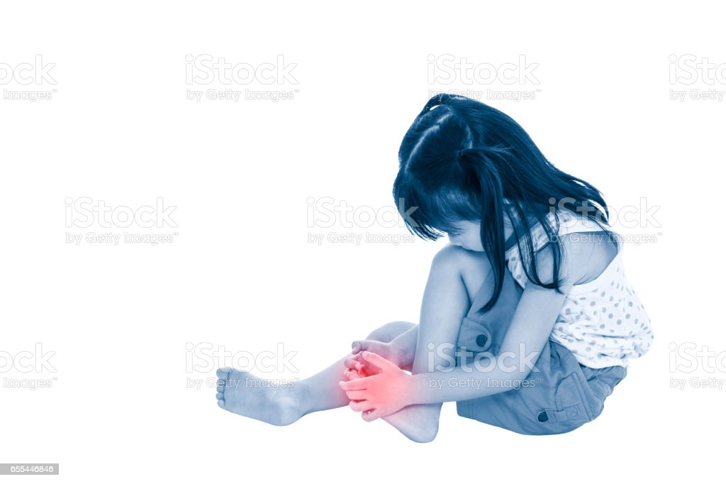 Sad asian child injured at toenail. Isolated on white background. stock photo