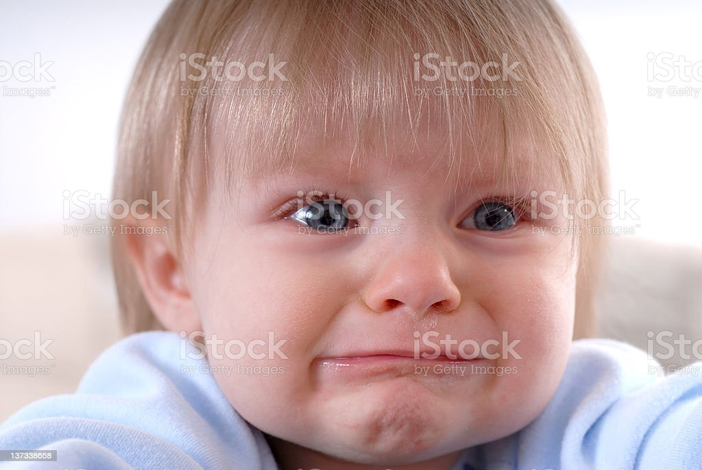 A sad baby about to burst into tears stock photo