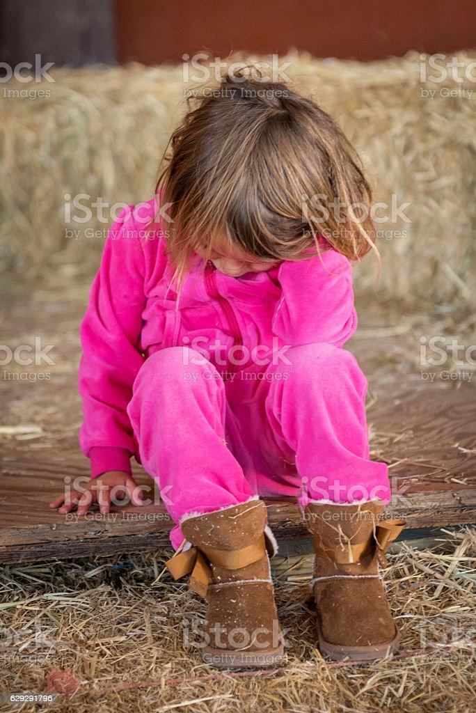 Sad Beautiful little girl stock photo