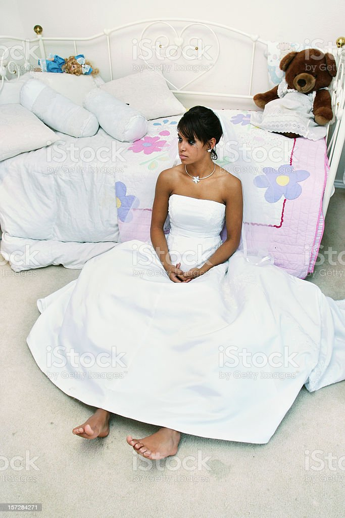Sad Bride Sitting in a Room royalty-free stock photo