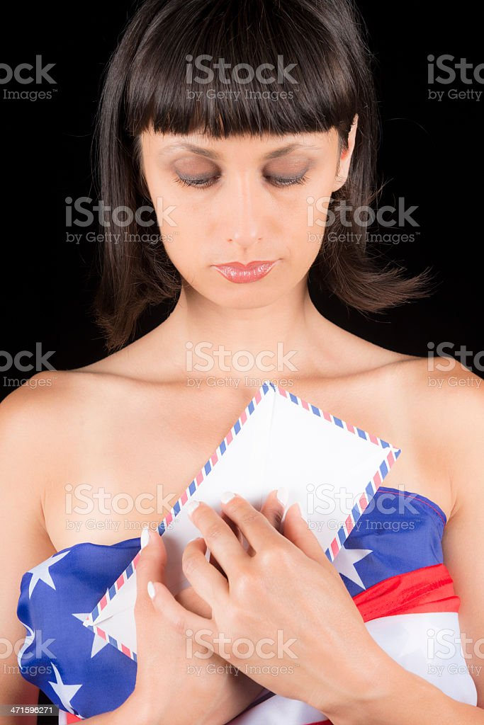 Sad Brunette with Letter and USA Flag royalty-free stock photo
