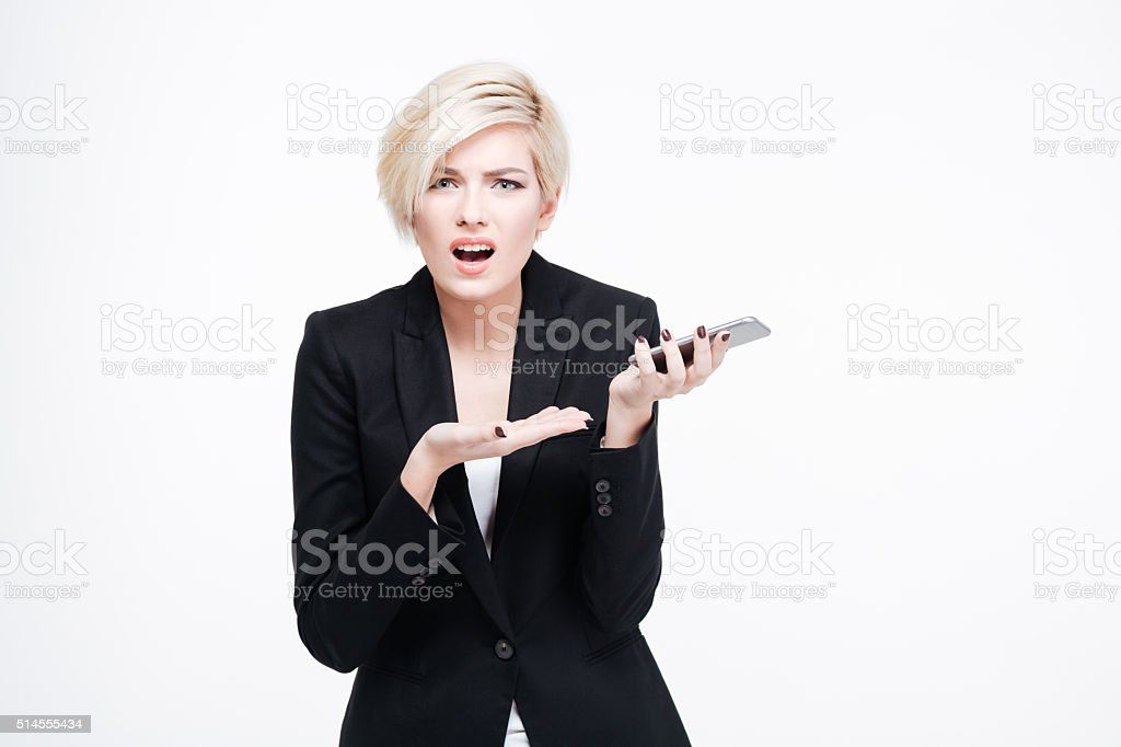Sad businesswoman holding smartphone stock photo