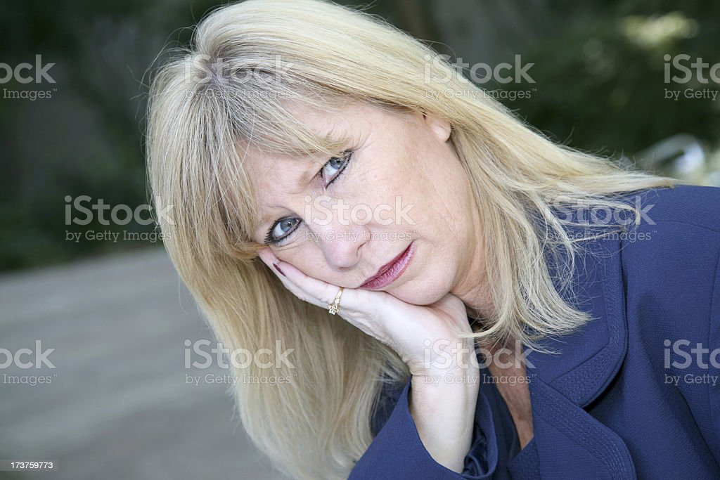 Sad Businesswoman With The World On Her Shoulders royalty-free stock photo