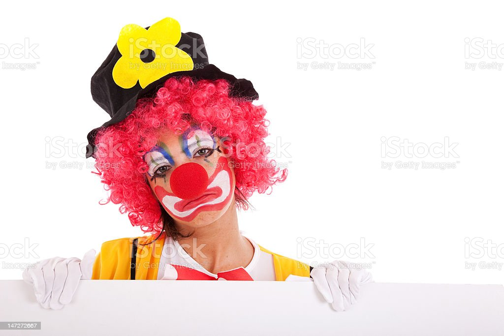 sad clown holding a banner stock photo