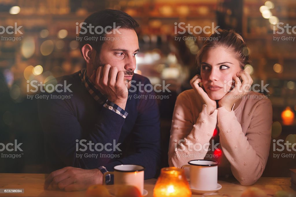 Sad couple having a conflict stock photo