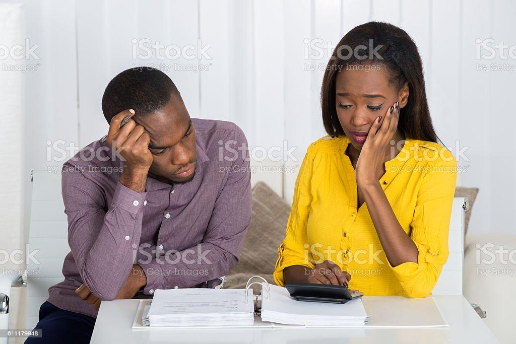 Sad Couple Looking At Bill stock photo