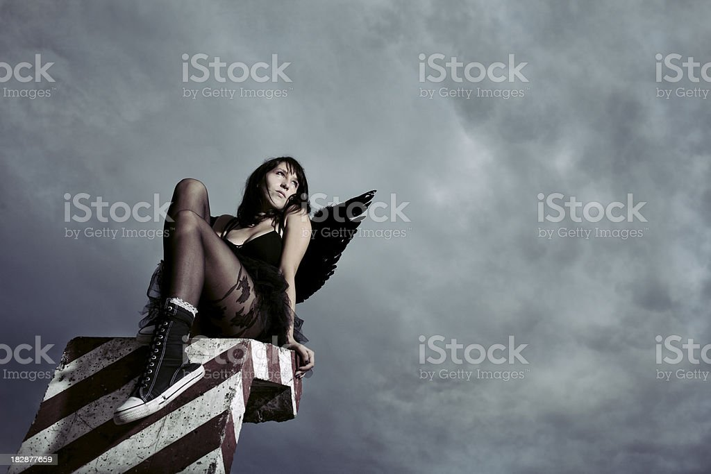 Sad dark female angel stock photo