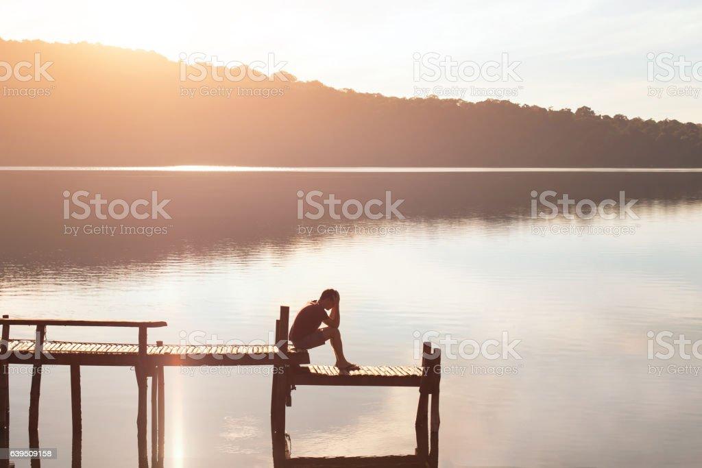 sad desperate man sitting alone, problems or failure concept stock photo